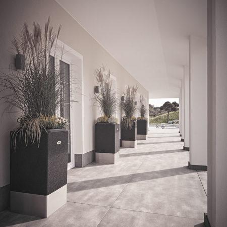 Mehrere Linea Edelstahl-Vasen als Design-Elemente